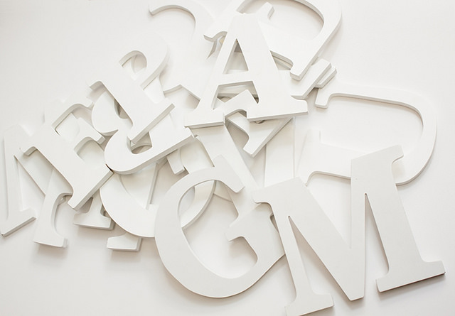 A jumble of white letters against a white background