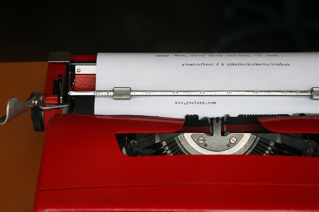 Typewriter has typed out the words www.youtube.com on a sheet of paper